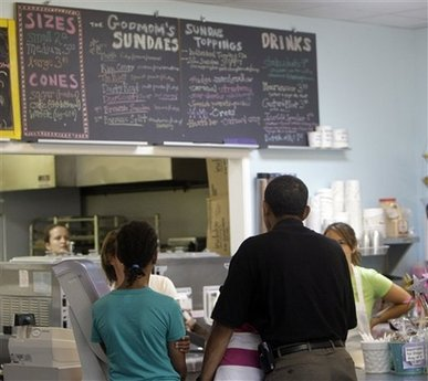 President Barack Obama stands with daughters Malia Obama, 10, left, and Sasha Obama, 8, and orders frozen custard at The Dairy Godmother in the Del Ray area of Alexandria, Va., Saturday, June 20, 2009.(AP Photo/Alex Brandon)